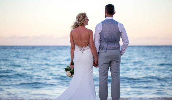 Bride and groom looking out at the ocean