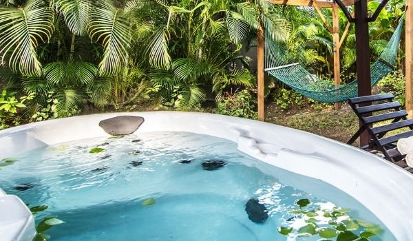 Hot tub surrounded by lush forest