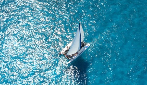 Aerial view of catamaran above a coral reef