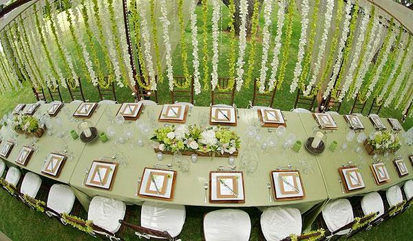 Wedding reception with green decor and lush centrepieces