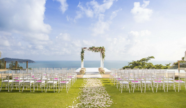 Wedding ceremony on a lawn overlooking the ocean