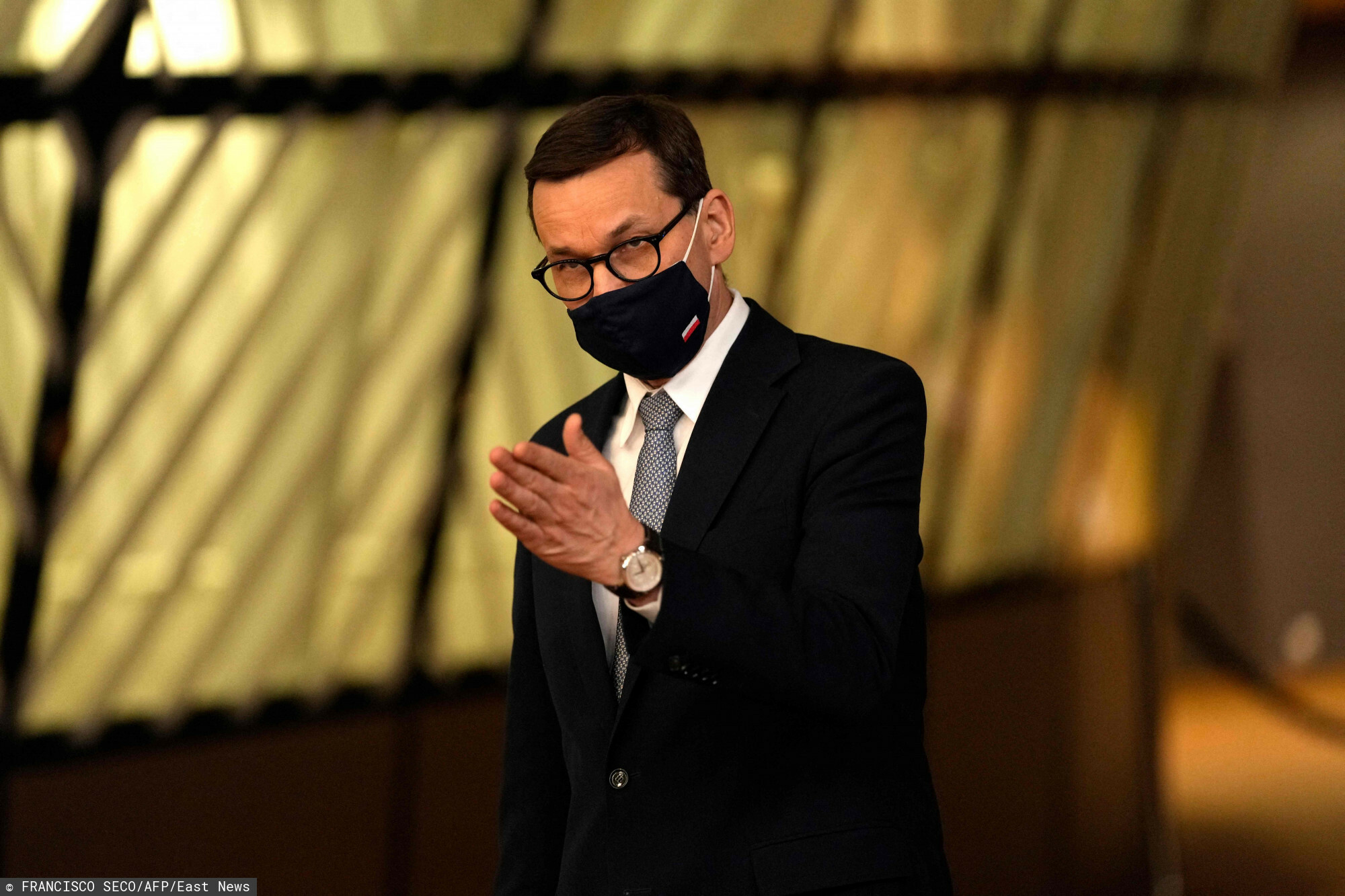 Poland's Prime Minister Mateusz Morawiecki speaks with the media as he departs at the end of the first day of the EU summit at the European Council building in Brussels on May 24, 2021. - European Union leaders take part in a two day in-person meeting to discuss the coronavirus pandemic, climate and Russia. (Photo by Francisco SECO / POOL / AFP)