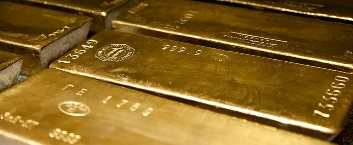 Four nines fine standard 400 oz gold bars.