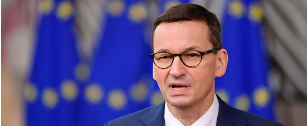 Poland's Prime Minister Mateusz Morawiecki speaks to the press as he arrives at the EU headquarters' Europa building in Brussels on December 10, 2020, prior to a European Union summit. (Photo by JOHN THYS / POOL / AFP)