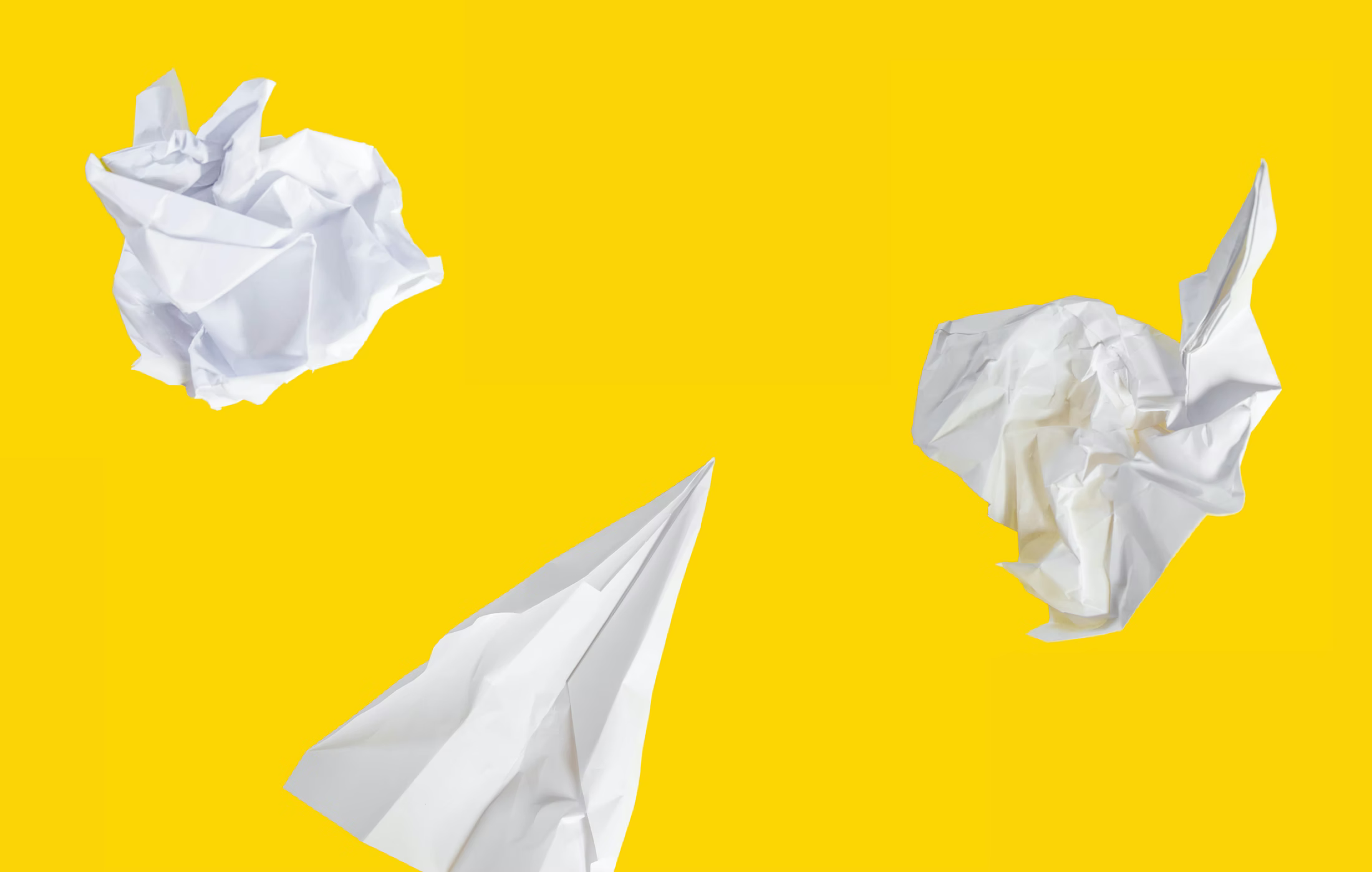 white paper airplane on yellow background