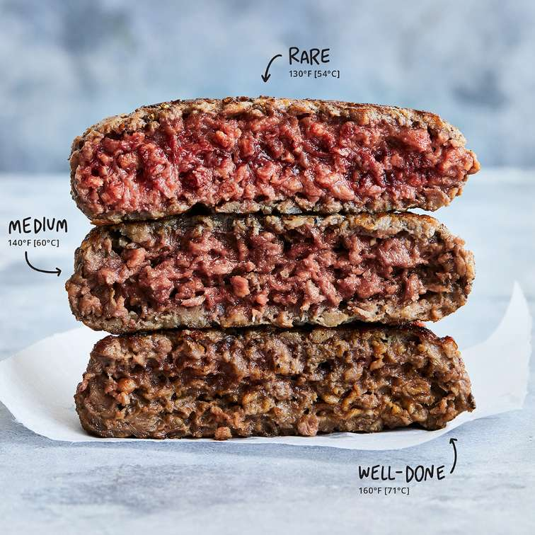 Three Impossible™ Burger patties with various cooking temperatures