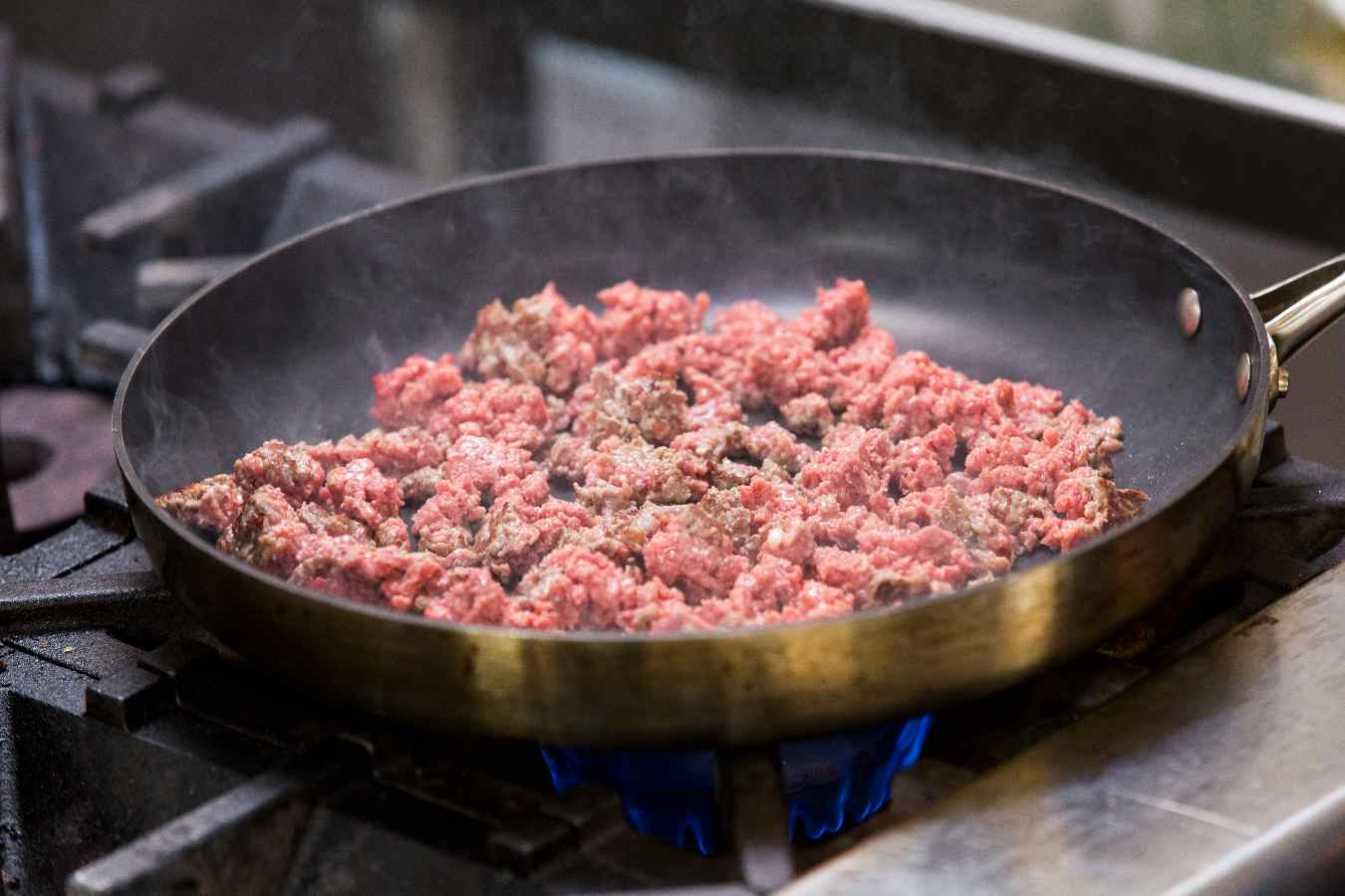 Sauteed Impossible™ Burger in a hot cooking pan in a restaurant.