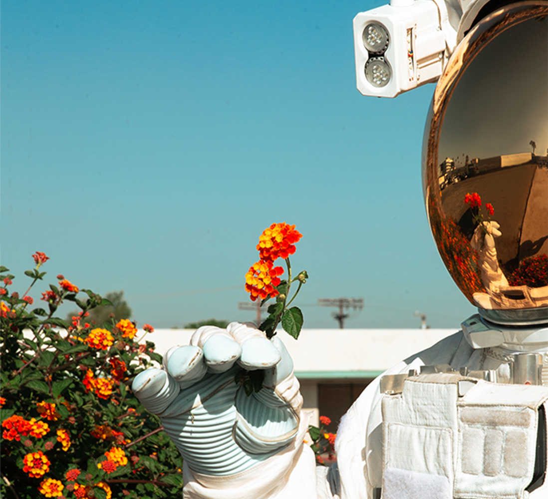 03 Mission Still Astronaut wFlower 1098x1000