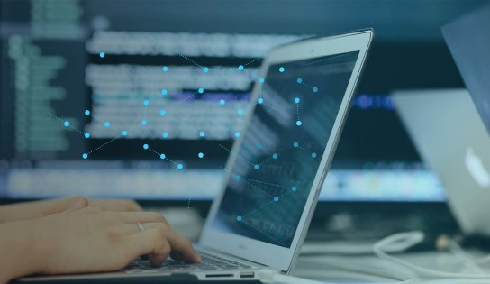 Person on computer with dots on screen