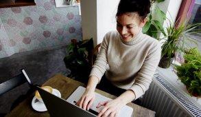girl in turtleneck on computer