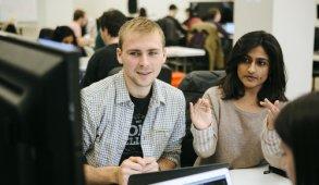 Vaidehi coding with classmates at Flatiron School
