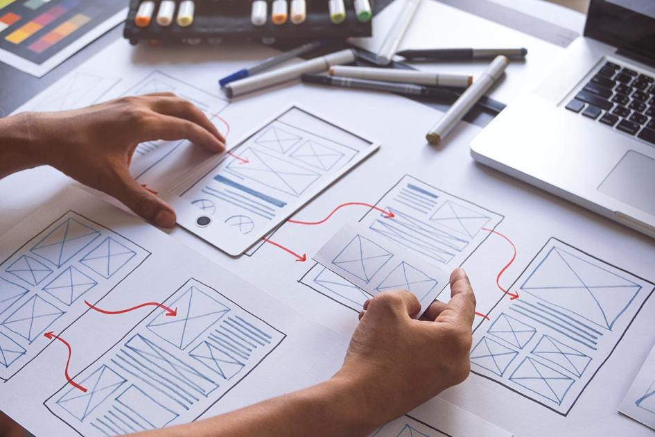 A UX/UI student creating wireframes
