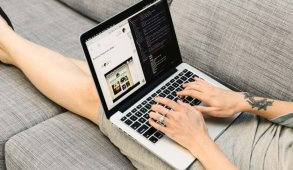 Blog Header: Woman working on laptop on couch