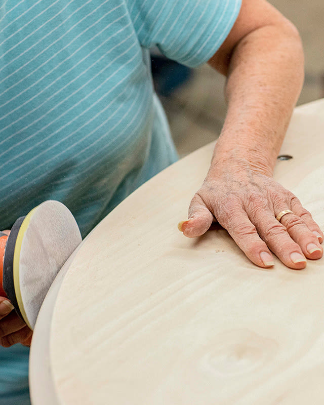 Sanding the edges of the Floyd Table.