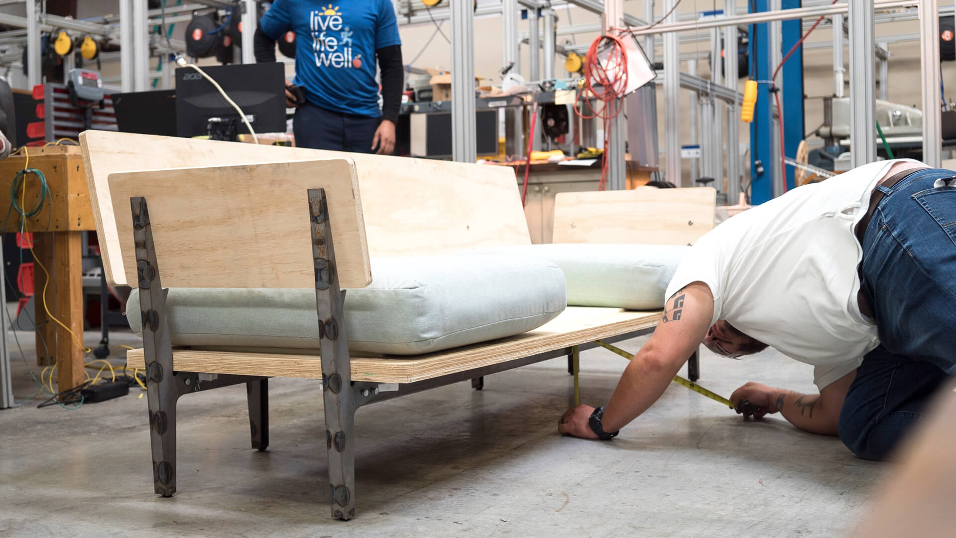 Man working on floyd sofa construction