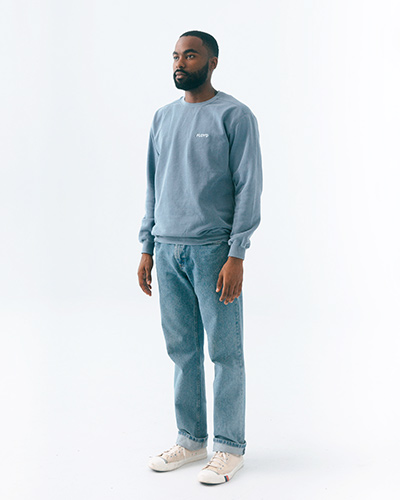 A person modeling the Floyd Crew sweater