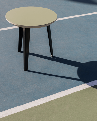 The Side Table in the middle of a tennis court.