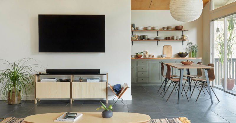 Media Console with an Oval Coffee Table in the foreground