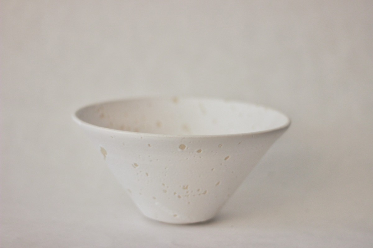 white recycled studio clay bowl on a gray background close shot