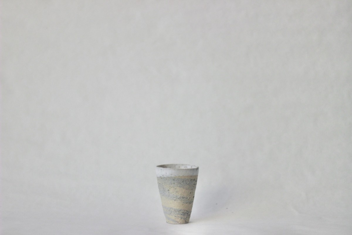 Mixed recycled clay cup on a gray background 1