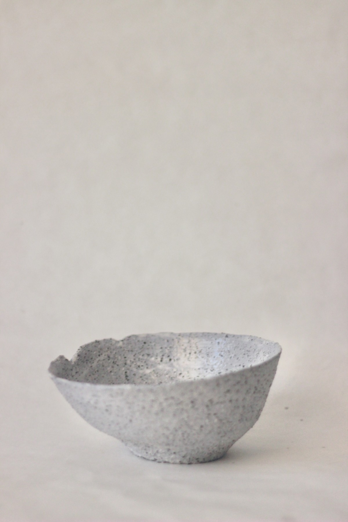 gray ceramic bowl on a gray background 2