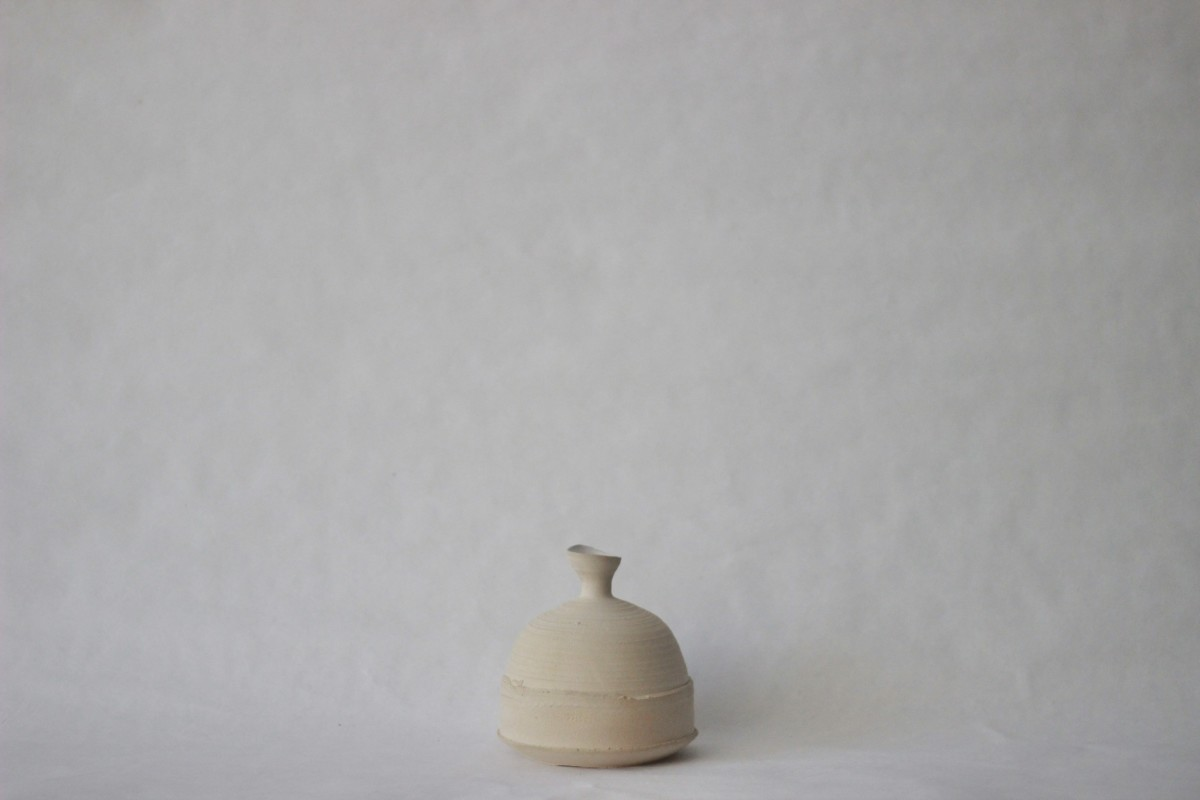 sand color clay vase on a gray background
