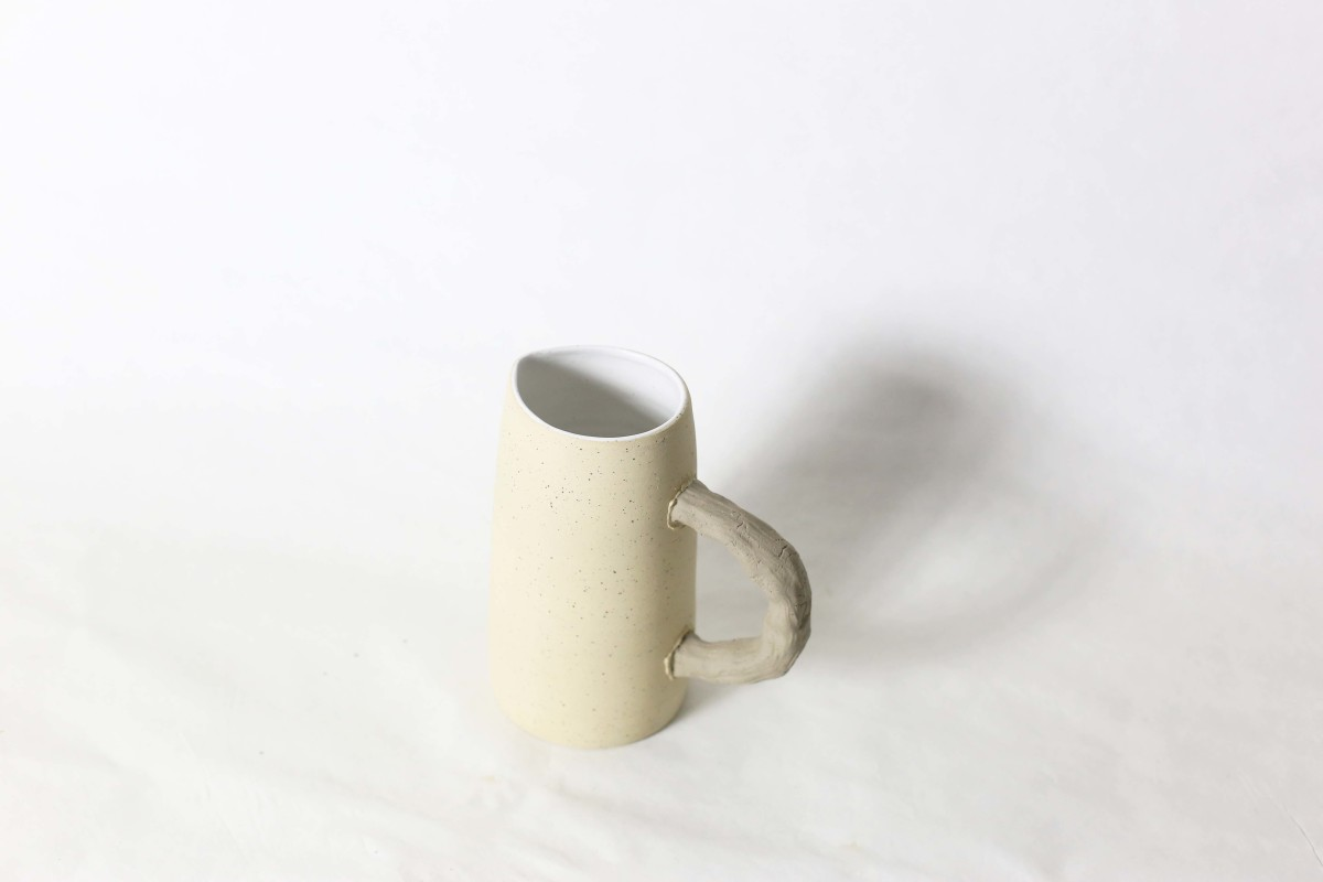 Beige ceramic jug on a white background over view