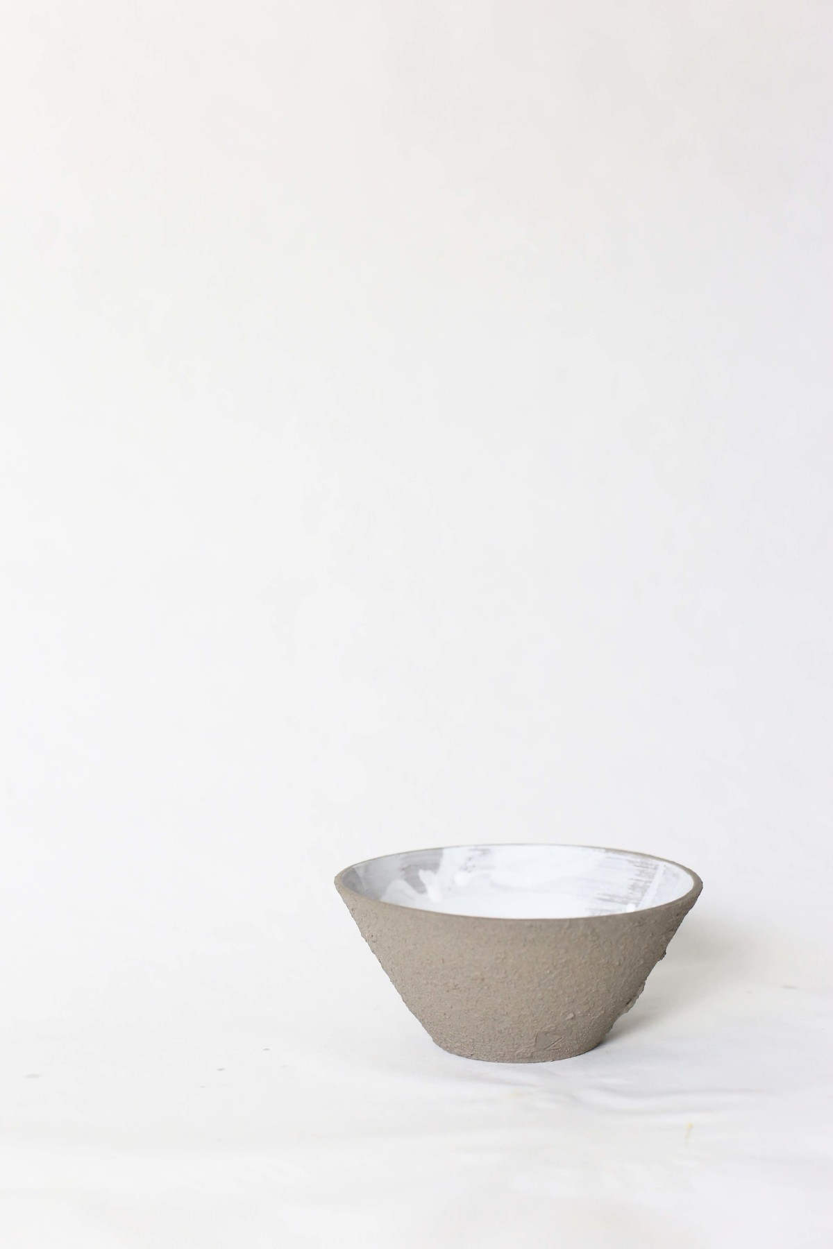graphite color clay bowl on a white background