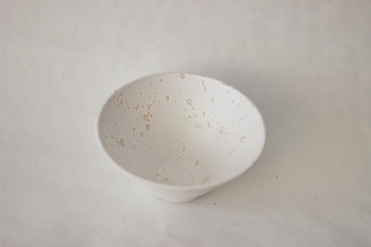 white recycled studio clay bowl on a gray background over view