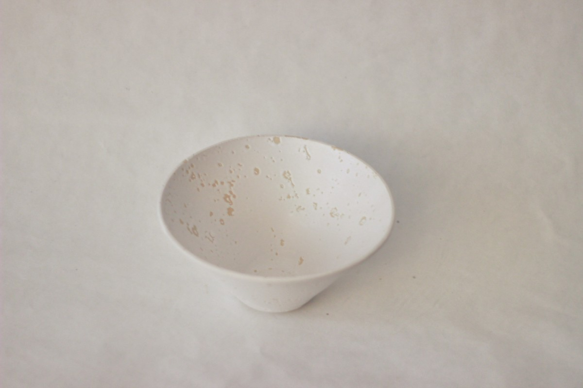 white recycled studio clay bowl on a gray background over view 1