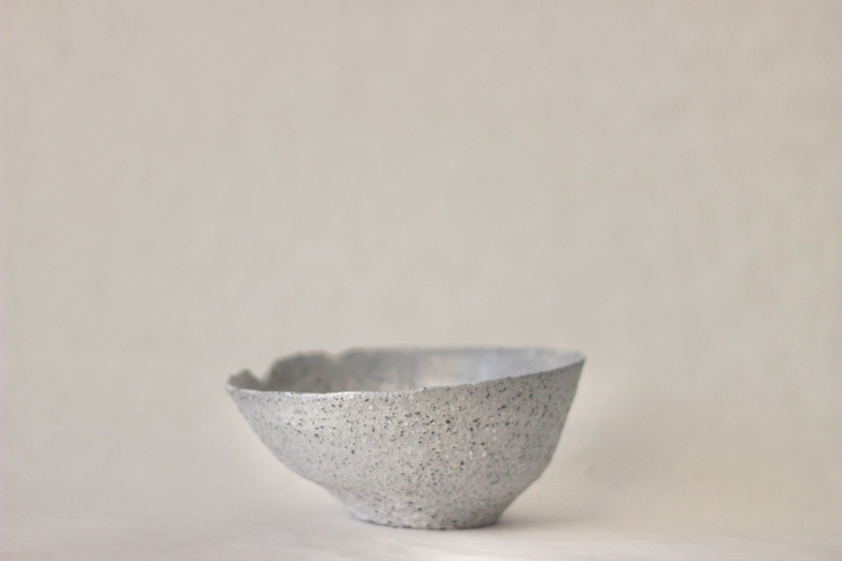 gray ceramic bowl on a gray background close shot
