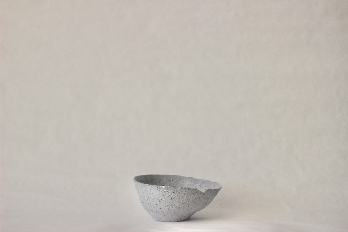 gray ceramic bowl on a gray background