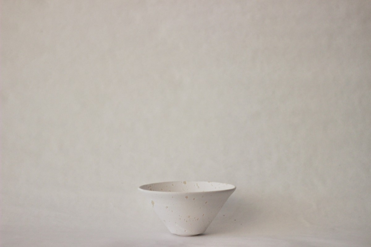 white recycled studio clay bowl on a gray background 1