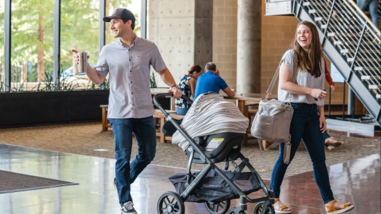 Family walking into Watermark Community Church with a stroller to Kids' Ministry.