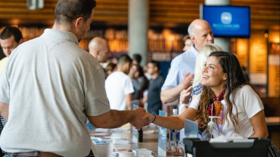 People interacting at the Welcome Center at Watermark Community Church Dallas campus.
