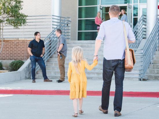Man and girl walking toward main entrance