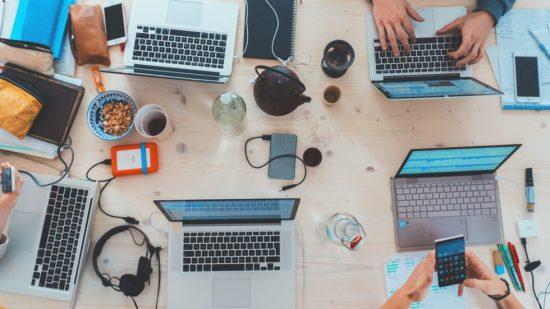 Laptops open on work table