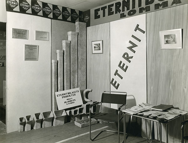 booth showing products by Eternit company, the word Eternit is written on the walls a number of times