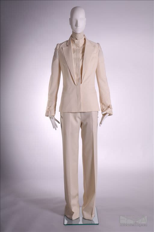 a full suit ensemble in a creamy white colour, displayed on a mannequin