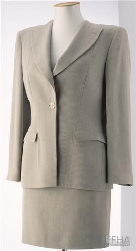 two-piece suit made of sand- and ecru-coloured, striped viscose, displayed on a mannequin