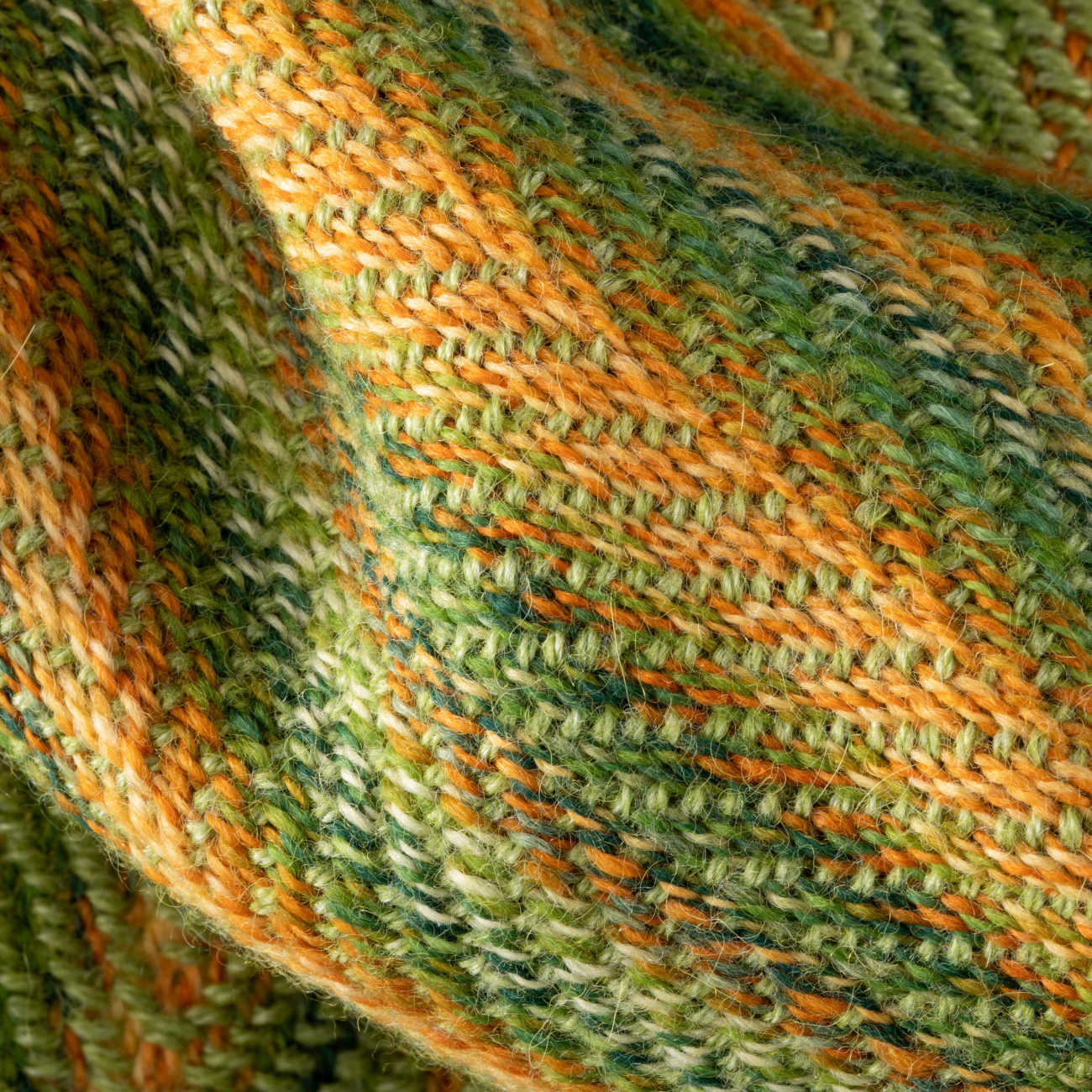 A close up of Nancy Peck's Double Faced Herringbone Scarf Little Looms 2021