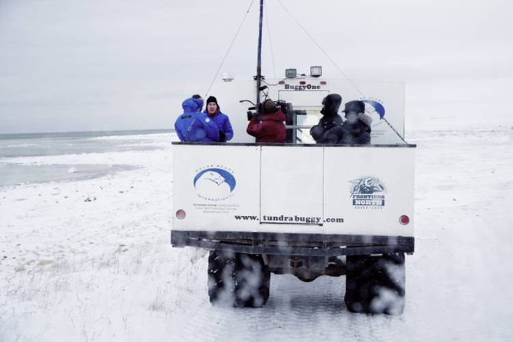 Tundra Buggy One traveling on ice with researchers on board