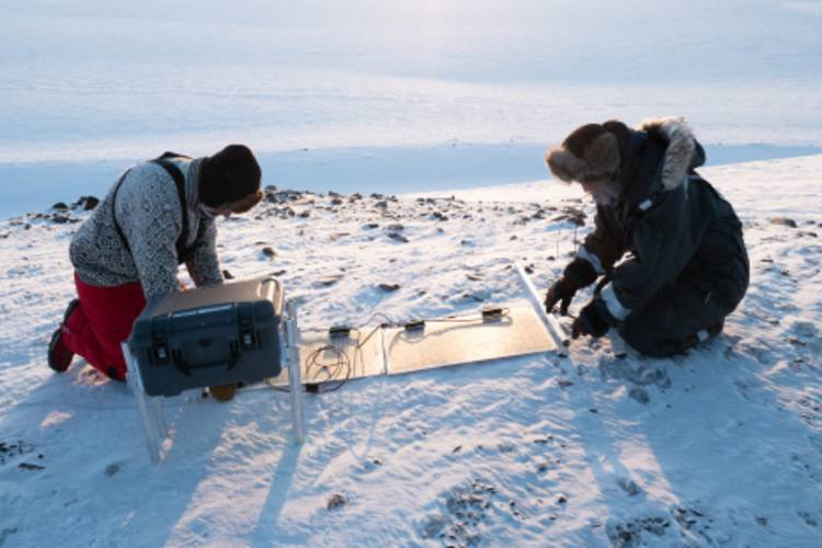 Researchers doing their work out in the Arctic image