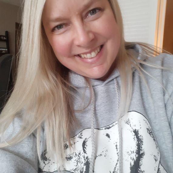 Selfie of Lenore N. wearing a polar bear hoodie