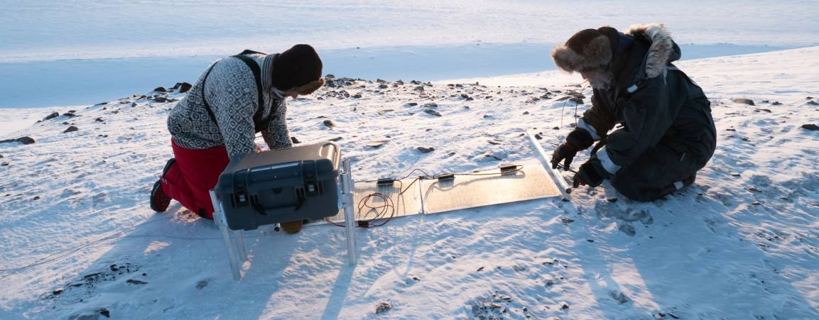 Two researchers working in the arctic