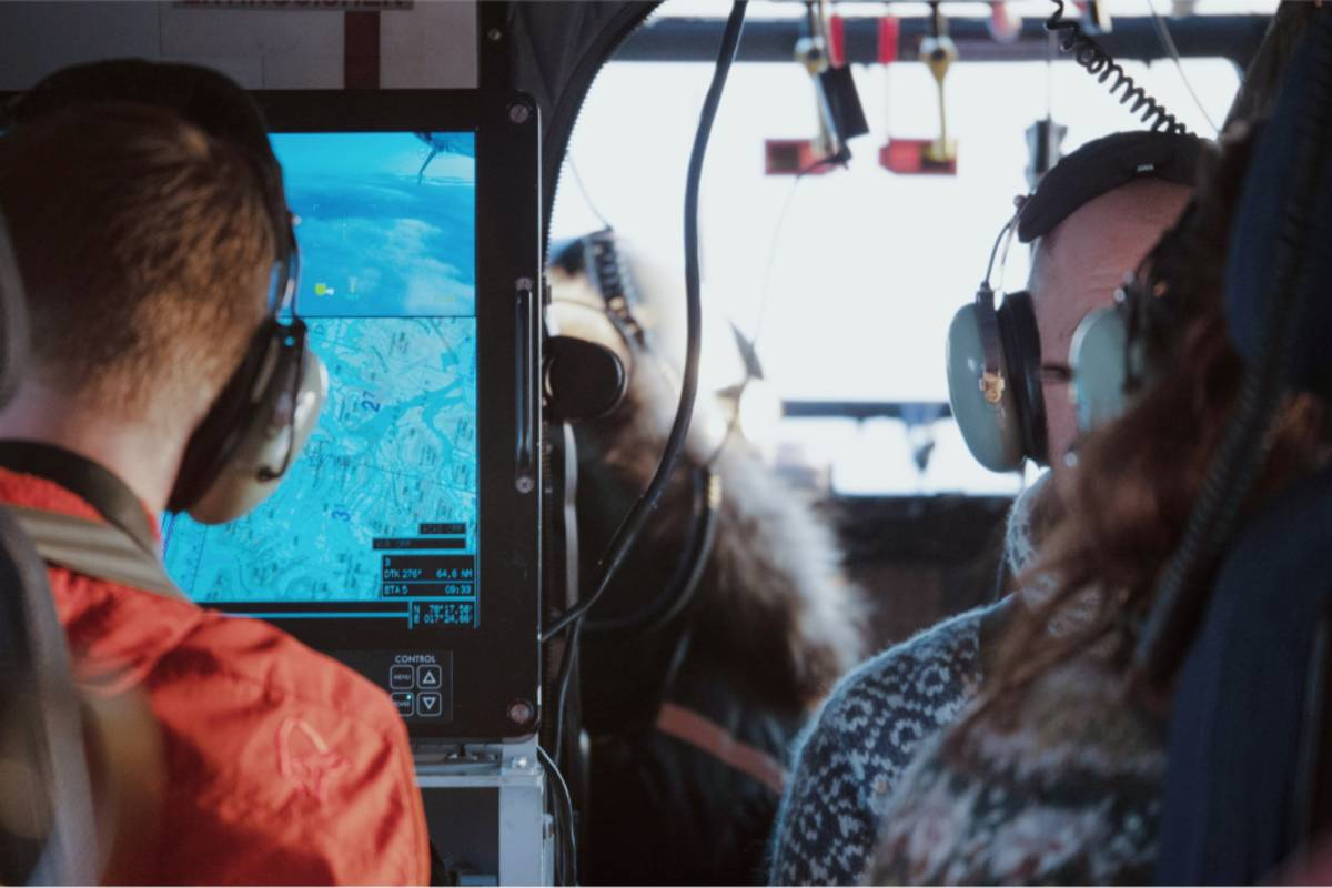 Researchers inside a helicopter