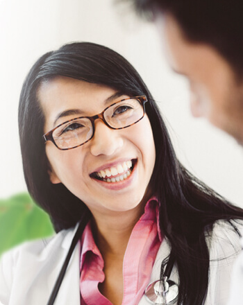 A female physician smiling to a patient