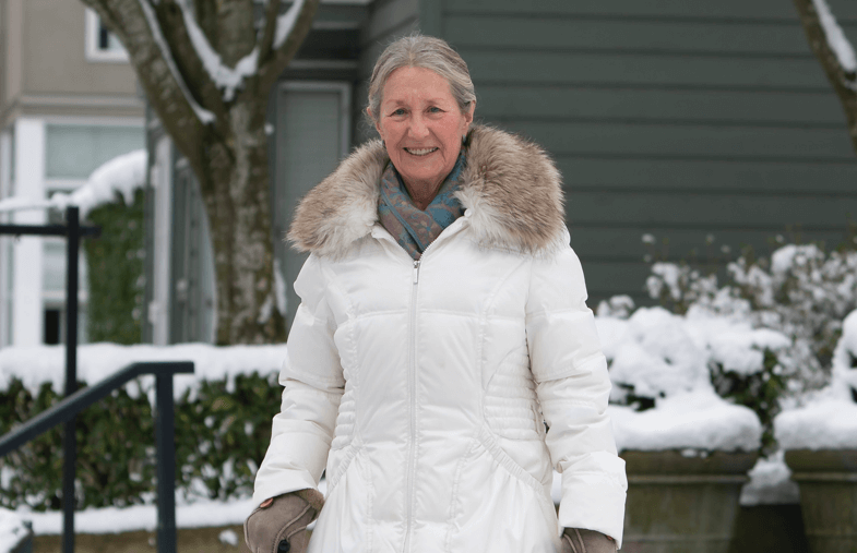Elderly lady in a parka on a Canadian winter day.