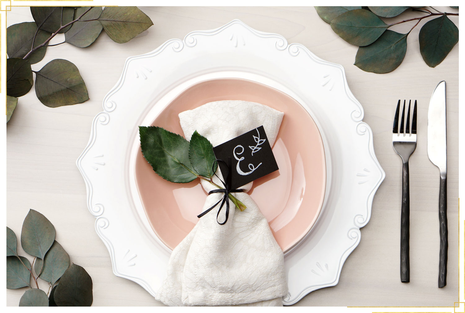 faux calligraphy table setting with white and pink plates