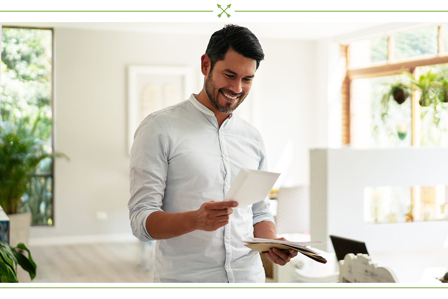 man smiling at a note from his friend